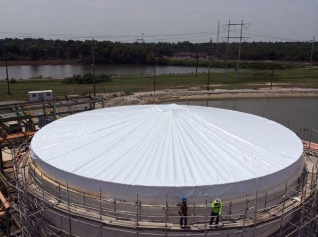 Large tank containment shrink wrapping services